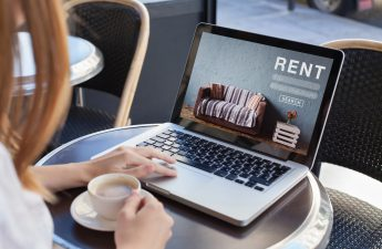 woman at laptop using top credit screening services for landlords