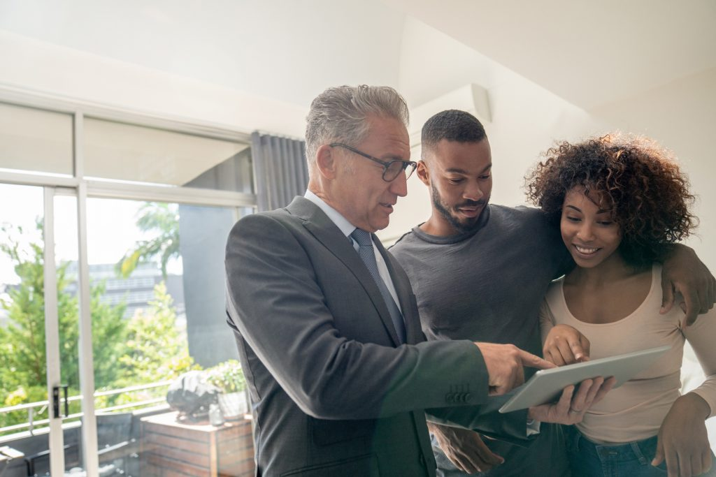Landlord reviewing rental criteria checklist and asking questions to potential tenants