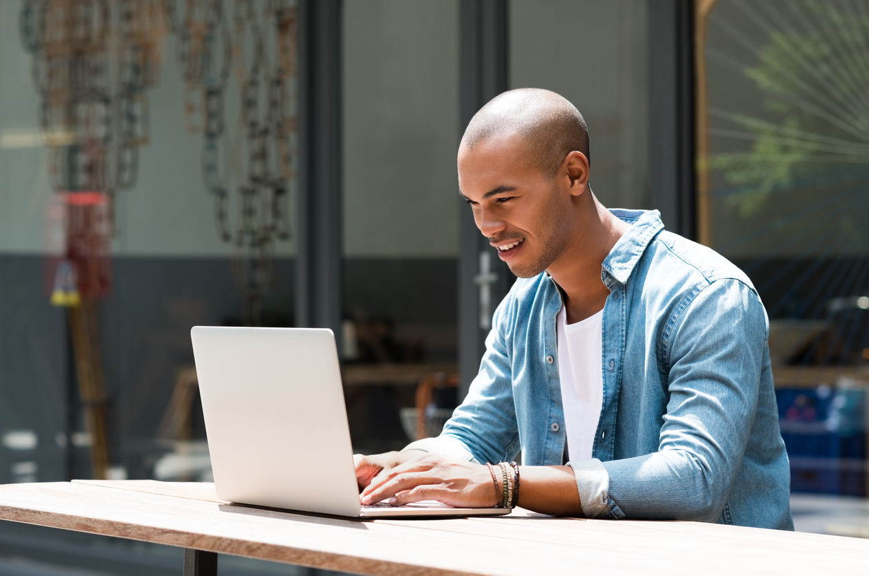 Young male tenant preparing to sign lease remotely on his laptop