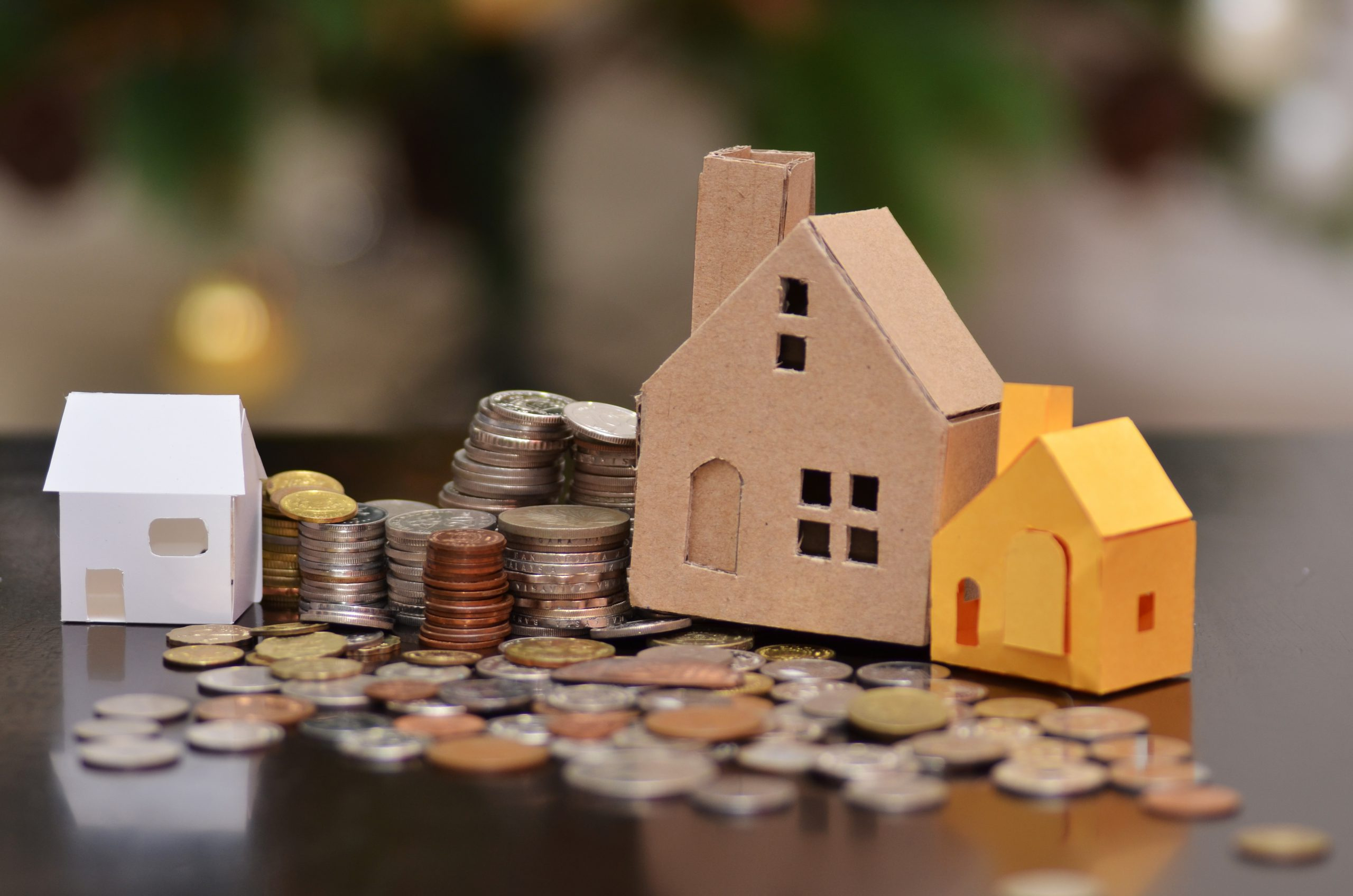 toy houses with coins