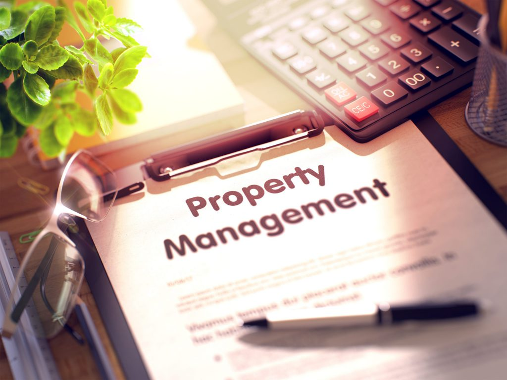 Business Concept - Property Management on Clipboard.